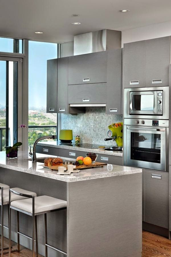 Horizontal cabinet over range with flanking vertical cabinets.
