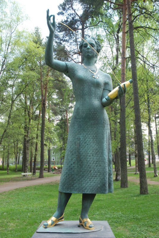 Atlas-Girl by sculptor Essi Renvall, 1954, Marianpuisto, Tampere - Sculpture of a young woman standing on a pedestal with golden sandals and golden pendant around her neck.The girl has a coppin in her hand with a thin gold wire. The symbolic meaning: 'Atlas' is satin based cloth bandage that is used mainly in the mountain silk.Atlas has also been Suomen Trikoo Oy's official brand/product label of the years 1913 to 1960. Photo: patsaanmetsastaja.blogspot.fi