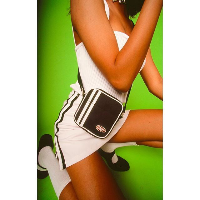 Women's athletic style skort with contrast piping down the sides and a rubber…