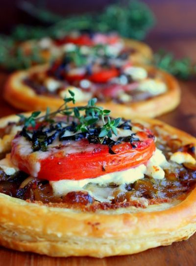Easy Tomato, Goat Cheese and Prosciutto Tarts. And I do believe they will MELT in your mouth. Recipe is from Ina Garten. Enough said:)