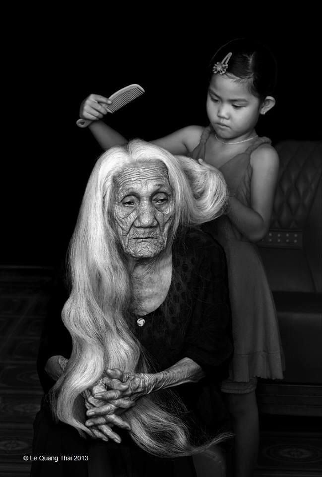 As a child, I loved brushing my grandmother's long, long hair!  There's so much beauty in this picture, I don't know how to absorb it all...if we have done our part and the children get it , then this is what the world should be!
