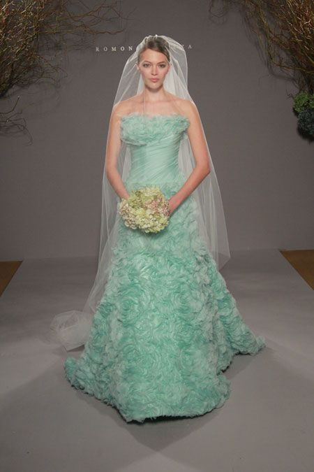 A Beautiful Light Turquoise Dress, Complimented By A Transparent White Veil