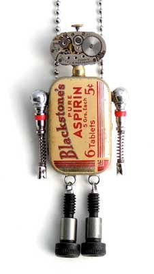 """Babybots   are composed of vintage aspirin, watch parts, or fishing sinker tins, watch movements, valve cores, and shoulder bolts. They come in a tin gift box and include a 30"""" ball chain that can be easily shortened. Best of all, each one opens up to reveal a heart inside."""