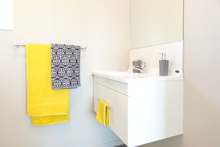 Add coloured towels to liven your bathroom.