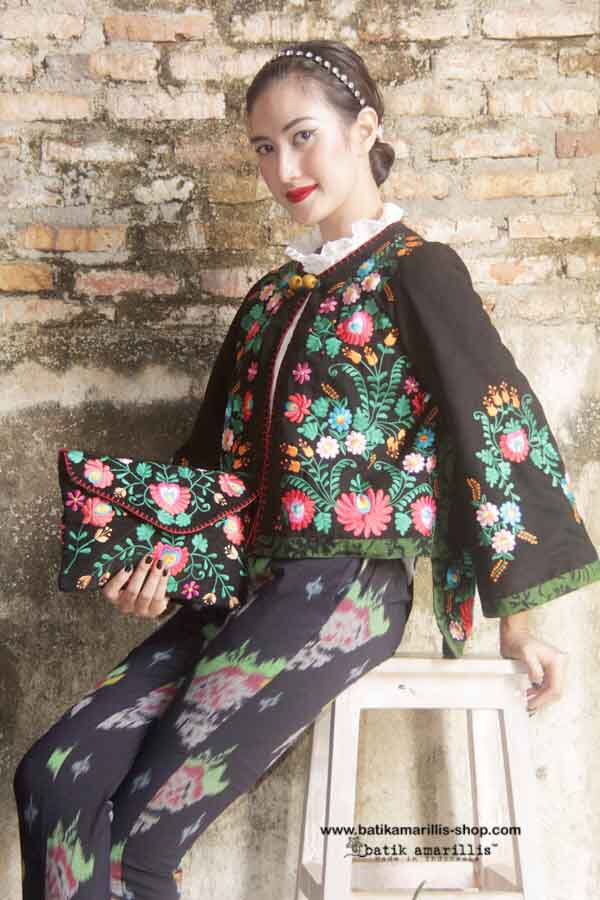Batik Amarillis Made in Indonesia. Batik Amarillis's Ildiko clutch Our super Chic embroidery clutch,features hungarian embroidery on cotton canvas which lined with Lurik Surjan Yogjakarta.