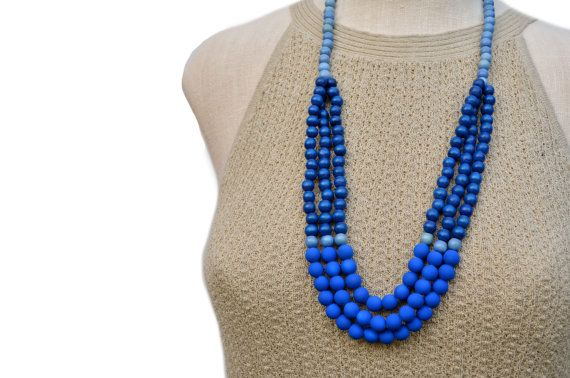 ¨¨¨¨¨¨¨¨¨¨¨¨¨°º⚛⚛⚛º°SHADES OF BLUE°º⚛⚛⚛º°¨¨¨¨¨¨¨¨¨¨¨¨  SHADES of BLUE is a gorgeous 3 strand necklace featuring 8mm periwinkle blue beads, 8mm cobalt blue wood beads, and bright neon blue rubberized beads. It closes with a silver plated lobster clasp. ► SIZE. This necklace measures 30 inches in length. IT IS ALWAYS A GOOD IDEA TO MEASURE YOUR NECK in order to ensure the perfect fit. If you would like this necklace shortened or lengthened, simply send me a convo, and I will be happy to adjust…