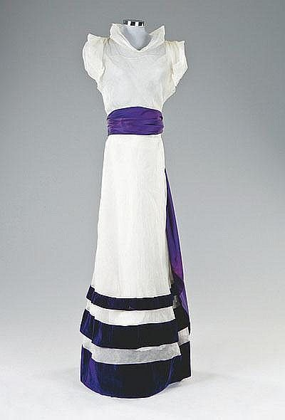 A Schiaparelli couture white organza summer gown, late 1930s, accenting the shoulder and slimming the waist.