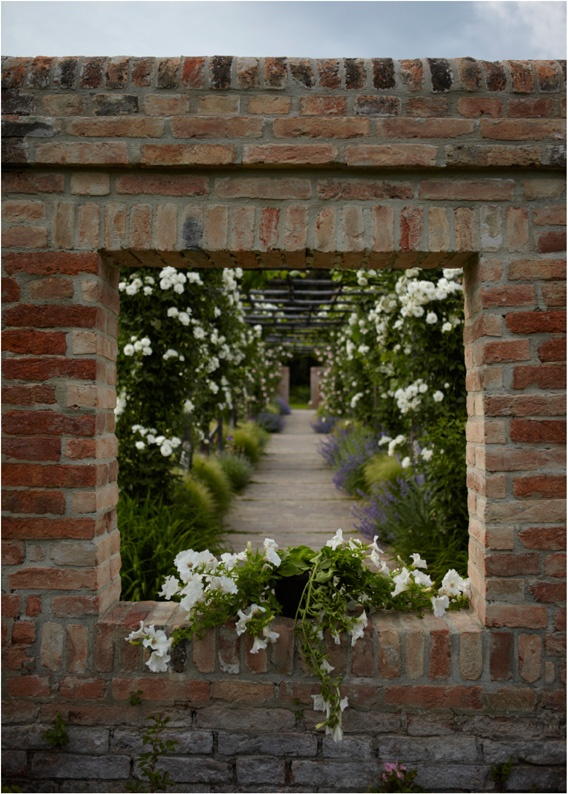 A window into, or out of, the garden adds an air of magic. Of course, this would mean that you have a walled garden, which in itself is secret, hidden away and  . . . absolutely enchanting!