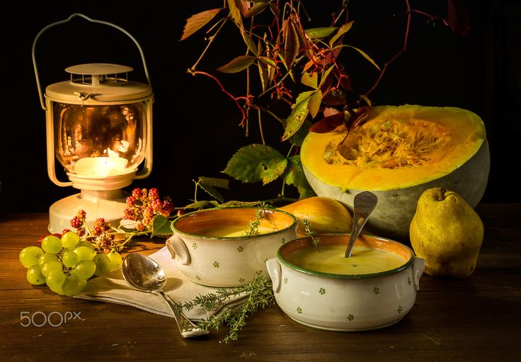 Autumn in the garden - Pumpkin,pumpkin soup,fruits and candle,still life with food.
