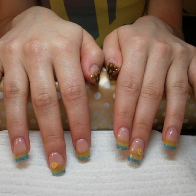 Gel nails with feathers, phylo clay ducks, and sparkle gels.