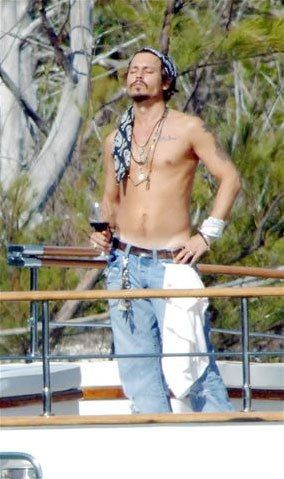 One of my favorite photos of Johnny Depp. A pirate on his