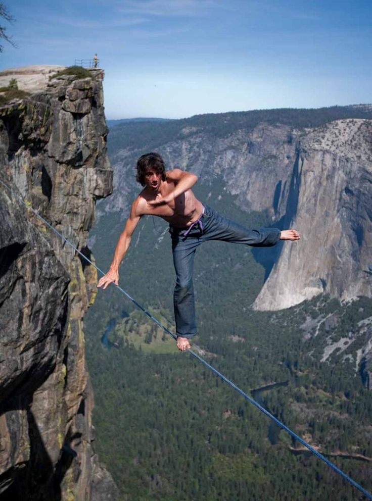slacklining-yosemite - Differing from tightrope walking in that the wire is more like a loose, narrow trampoline, slacklining is an athletic trend that has grown considerable popularity in the past few decades.