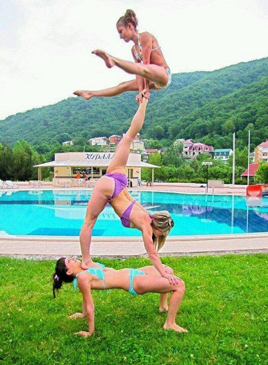 Cheerleading in swimsuits, by the pool... Girls these days...