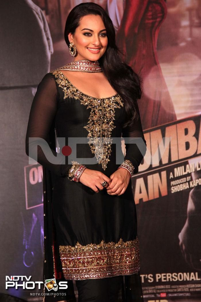 The dons and their belle Sonakshi: Sonakshi Sinha glittered in a gold embroidered black salwar suit at the first look launch of Once Upon A Time In Mumbaai Again.