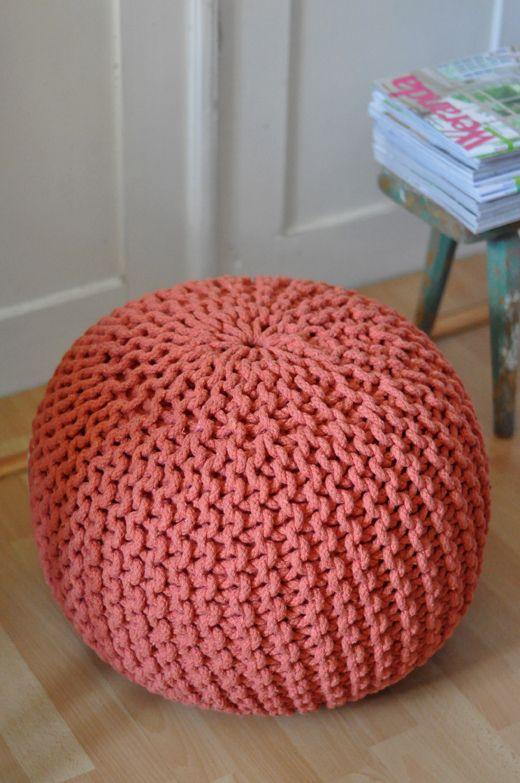 Hand knitted round floor cushion in orange / camel
