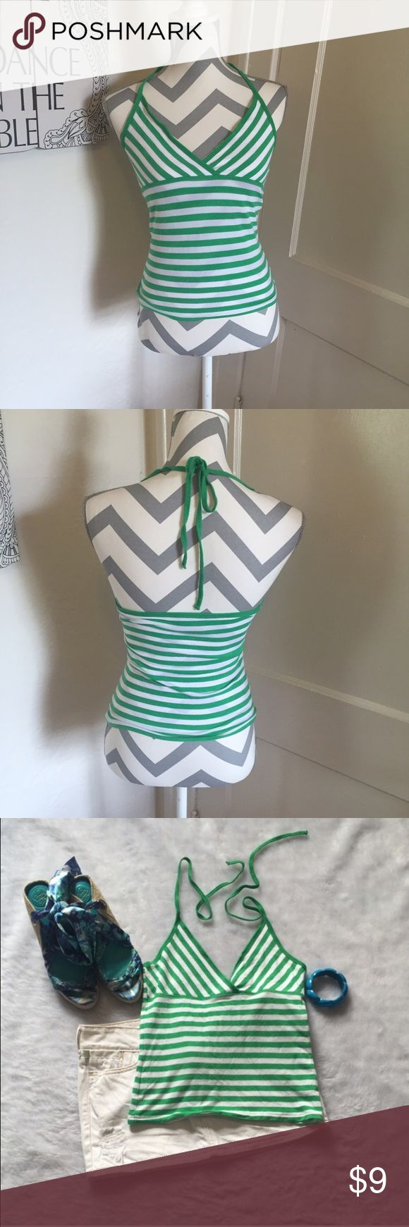 Polo striped halter Polo jeans co striped halter Green and white  Size small, short and could be worn as a crop top gently used Please ask for additional pictures, measurements, or ask questions before purchase No trades or other apps. Ships next business day, unless otherwise noted in my closet Reasonable offers accepted  Five star rating Bundle for discount Polo by Ralph Lauren Tops