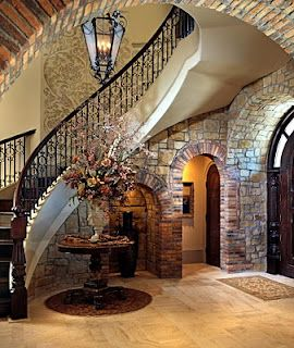 luxury rustic home. spiral staircase, stone walls