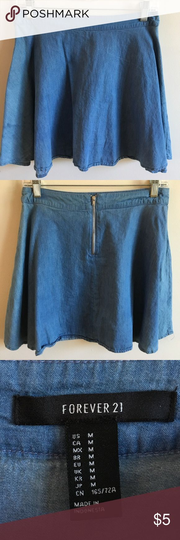 Faux Denim Skater Skirt Skater skirt that has denim-like material with medium/light wash. Very little fading but it adds to the appearance of the skirt. No elasticated waistband, zip-up back. Great condition. Forever 21 Skirts Circle & Skater
