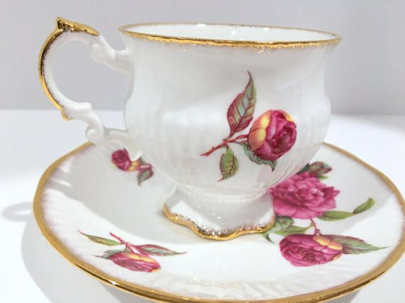 Happiness abounds with the freshness of flowers. Royal Crest Bone China of England produced this shapely, charming tea cup and saucer. Measurements: The saucer is 5.75 in diameter. The cup is 3.25 high and 3 from rim to rim. This English teacup and saucer is in excellent condition.