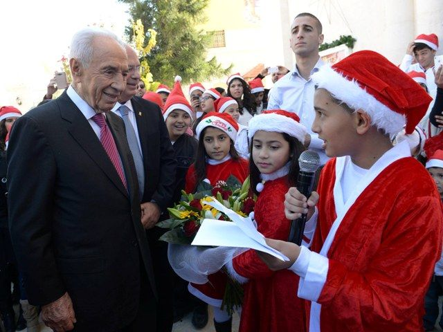 President Peres extends Christmas greetings!  President Peres visited the Franciscan Catholic Church in Ramla in honor of Christmas and delivered a festive greeting to Christians all over the world