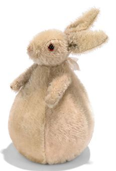 A STEIFF ROLY-POLY RABBIT, (323), pale pink and white mohair, black boot button eyes, red felt behind, pink stitching, whiskers, swivel head, jointed arms, weighted body with rattle and FF button, circa 1910 --8in. (20.5cm.) high (some wear and thinning)