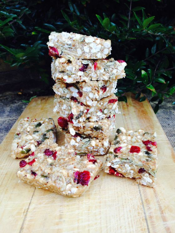 Homemade clean granola bars made with cranberries, pumpkin seeds and peanut butter. No baking required - Hedi Hearts