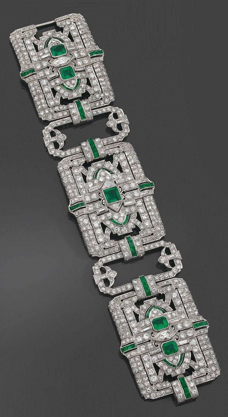 A rare and spectacular Art Deco platinum, diamond and emerald bracelet, by Yard,...
