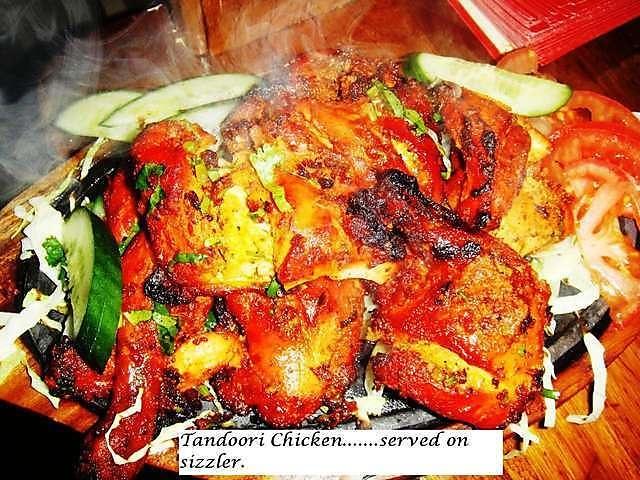 tandoori chicken in Indian restaurant at @Dévi R Flames