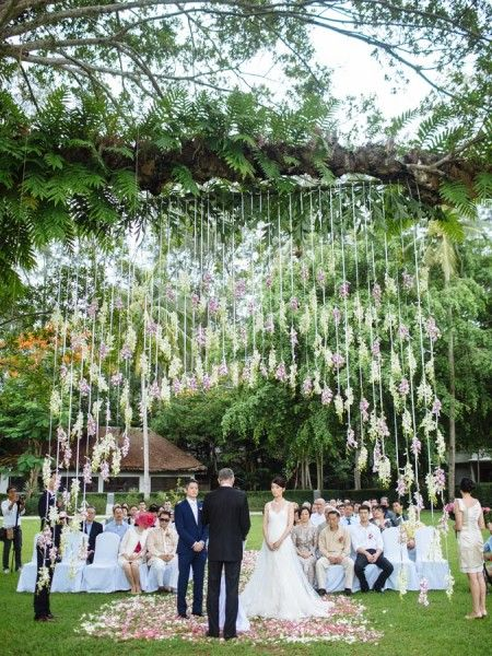 Outdoor ceremony at a destination wedding in Phuket, Thailand. Venue: Indigo Pearl.