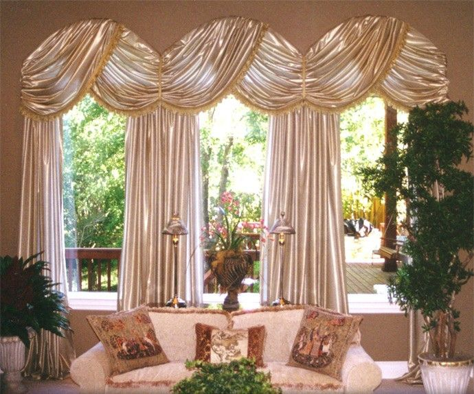 Custom arched window treatment for a carolina room for Arched kitchen window treatment ideas