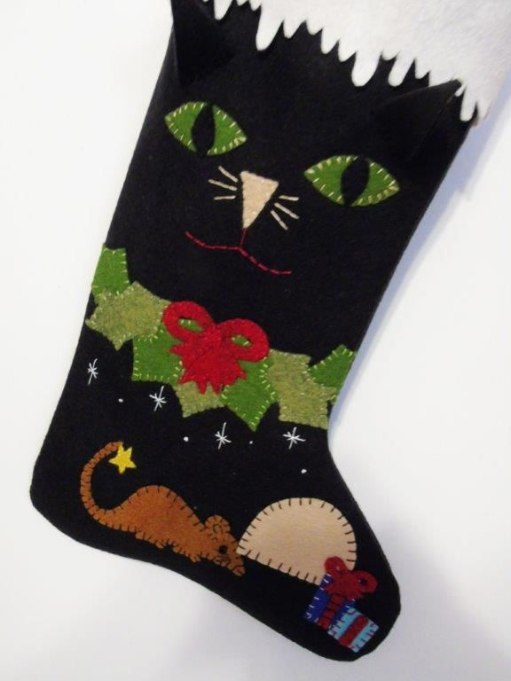 Even the cat needs his own stocking for Christmas. A Cheswick Company design