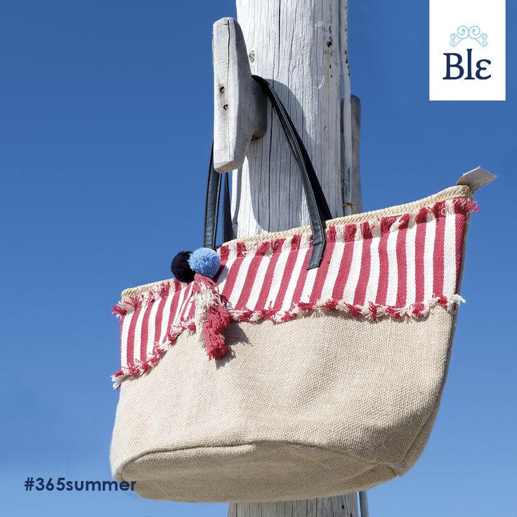 """Want more from your bag? This Ble marvelous bag keeps everyone """"hanging on"""" and wanting more! An earthly colour base and an added patch fabric in red and white stripes, destined to match all looks, mixes with tiny details that makes all the difference –colourful, little pompons and tassels. Find the bag here http://www.ble-shop.com/bags.html"""