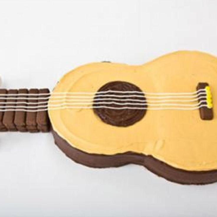 Sweet! How to make a guitar birthday cake with chocolate-covered wafer cookies. Easy, step-by-step recipe, diagrams and pictures - parenting.com