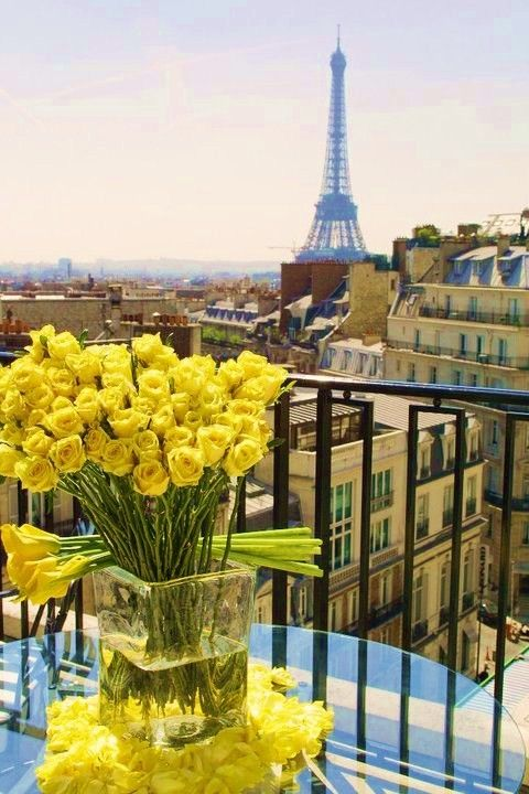 Yellow roses, tulips and a balcony in Paris w/ a view of the eiffel tower = Perfect day
