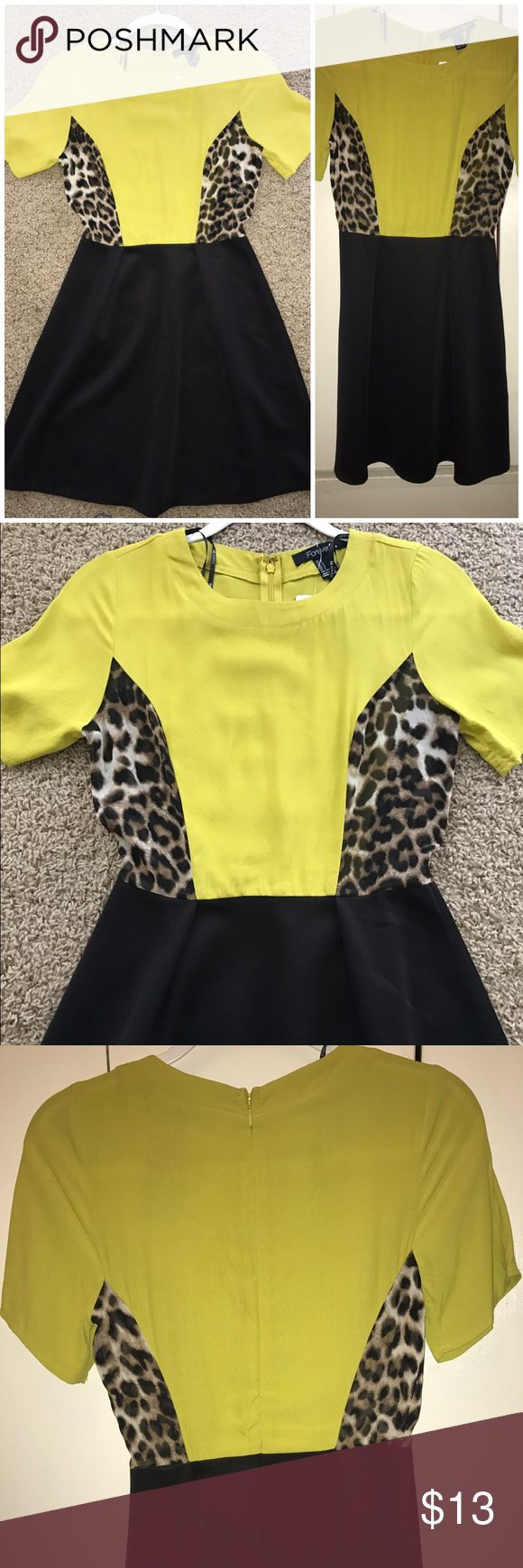 Yellow/leopard print mixed scuba skirt dress NWT from Forever 21! Never worn! The top is a chartreuse yellow color and a faux silk material. The sides have a slightly sheer leopard print pattern which makes it so fun! Lastly, the attached skirt is an easy scuba fabric. Forever 21 Dresses