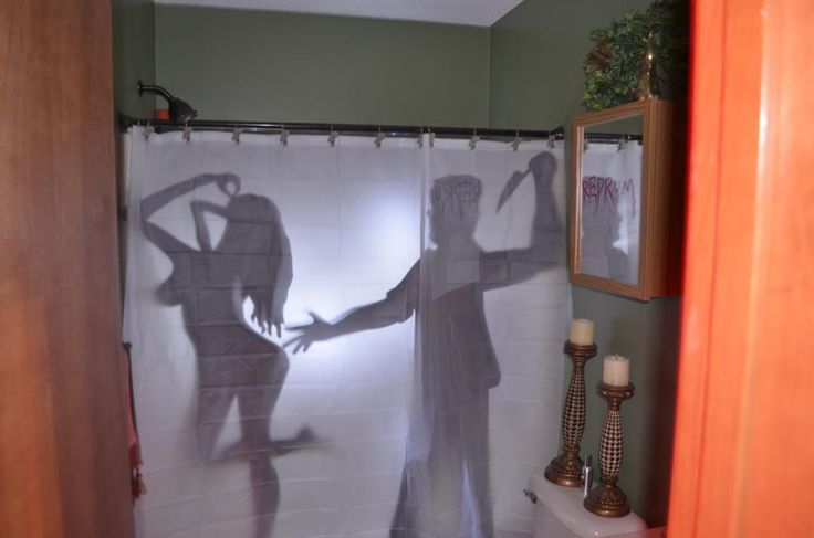 This person made silhouettes out of cardboard and put a strobe behind it.  Halloween Forum