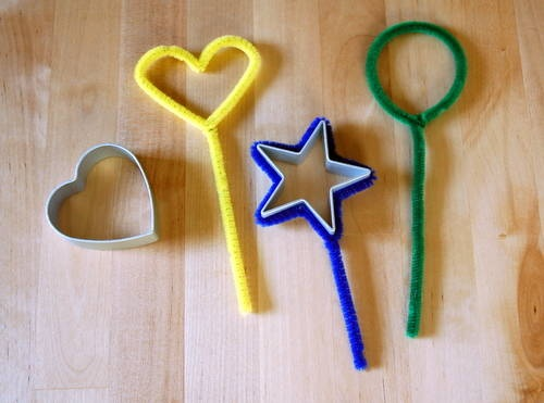 Make bubble wands out of pipe cleaners shaped around cookie cutters