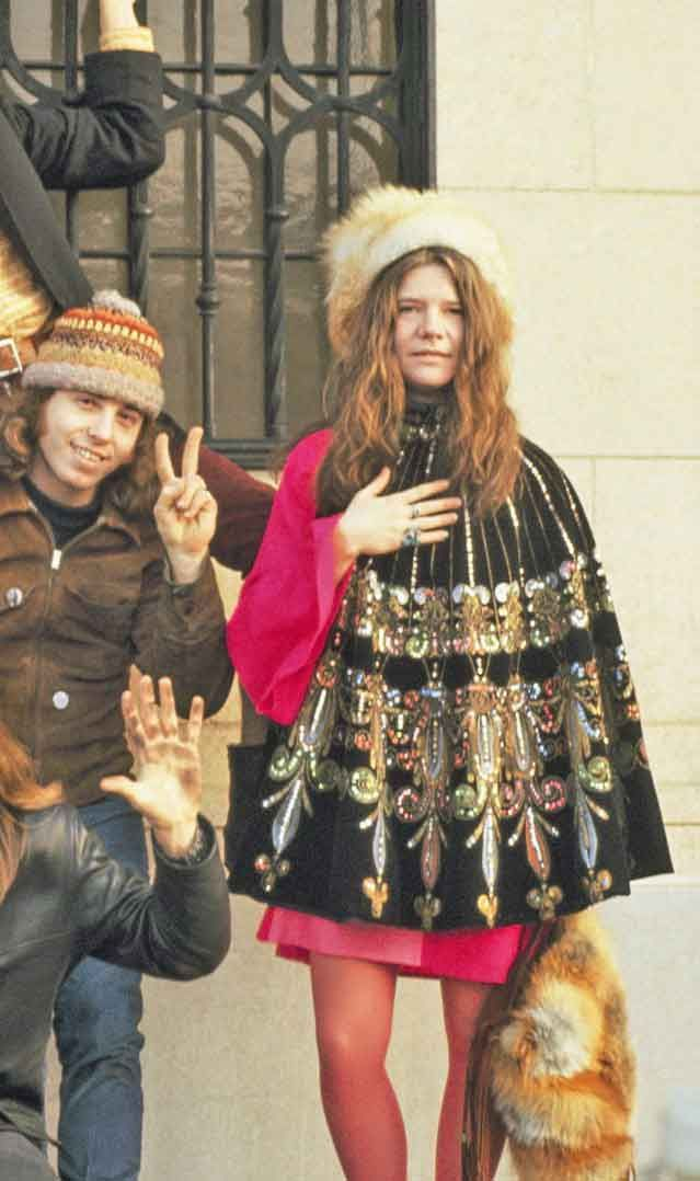 Janis Joplin sporting a magnificent cape ,not to mention her super hotpink tights