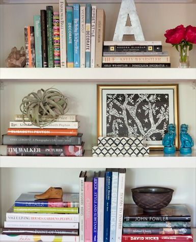 Basically-HOW the heck to organize the stuff on your book shelves so they look like they belong in an interior design magazine.