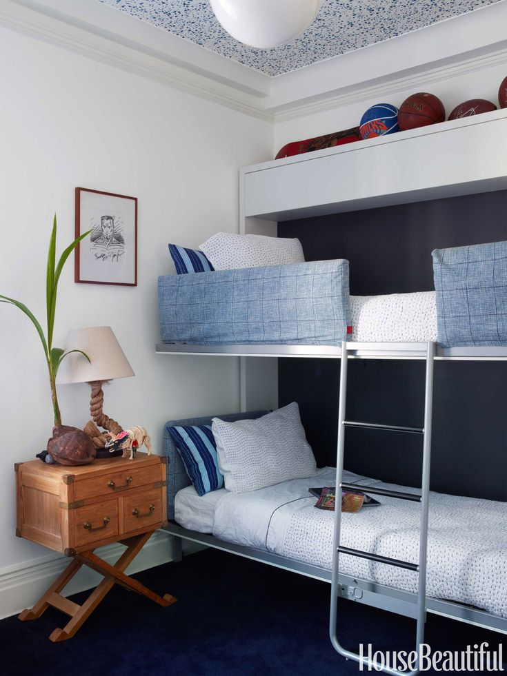 Murphy bunk beds from Resource Furniture fold into the wall to give the son extra playing space. Walls are painted in Benjamin Moore's Cotton Balls, and the ceiling is lined with Donghia's Spatter wallpaper. John Robshaw Textiles bed linens. Serena & Lily table.   - HouseBeautiful.com