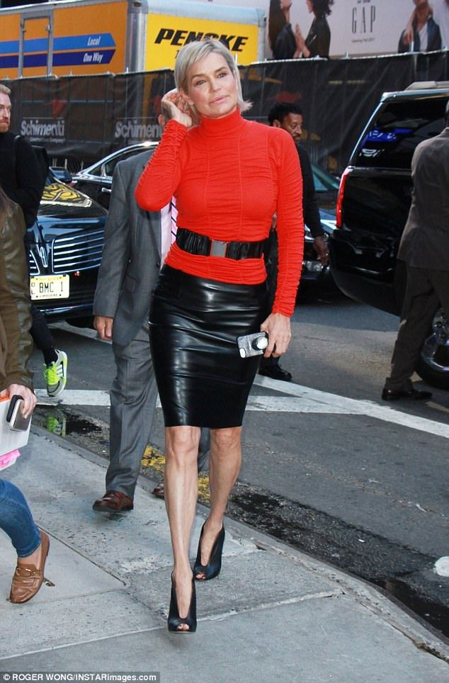 Looking good in leather:The leather skirt perfectly complimented the reality TV star's slim pins. She capped off the ensemble with a pair of leather heels that featured peek-a-boo toes.