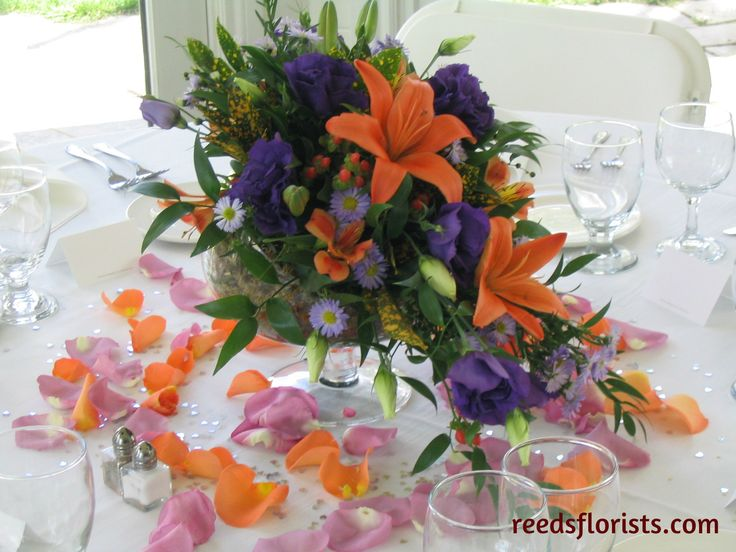 Tons of colour and texture in these bright table centres. Flowers by www.reedsflorists.com