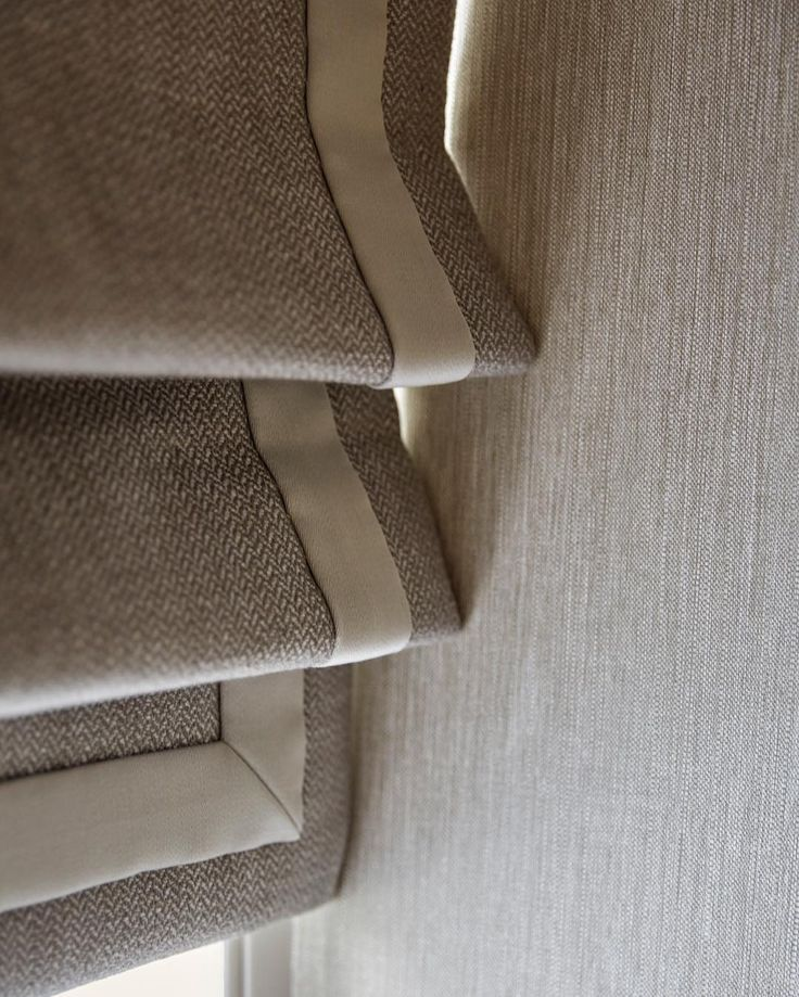 Roman blinds in a grey herringbone with a contrast border