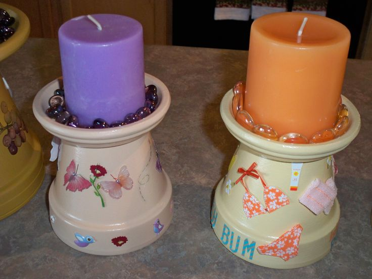 Candle holders made from clay pots.