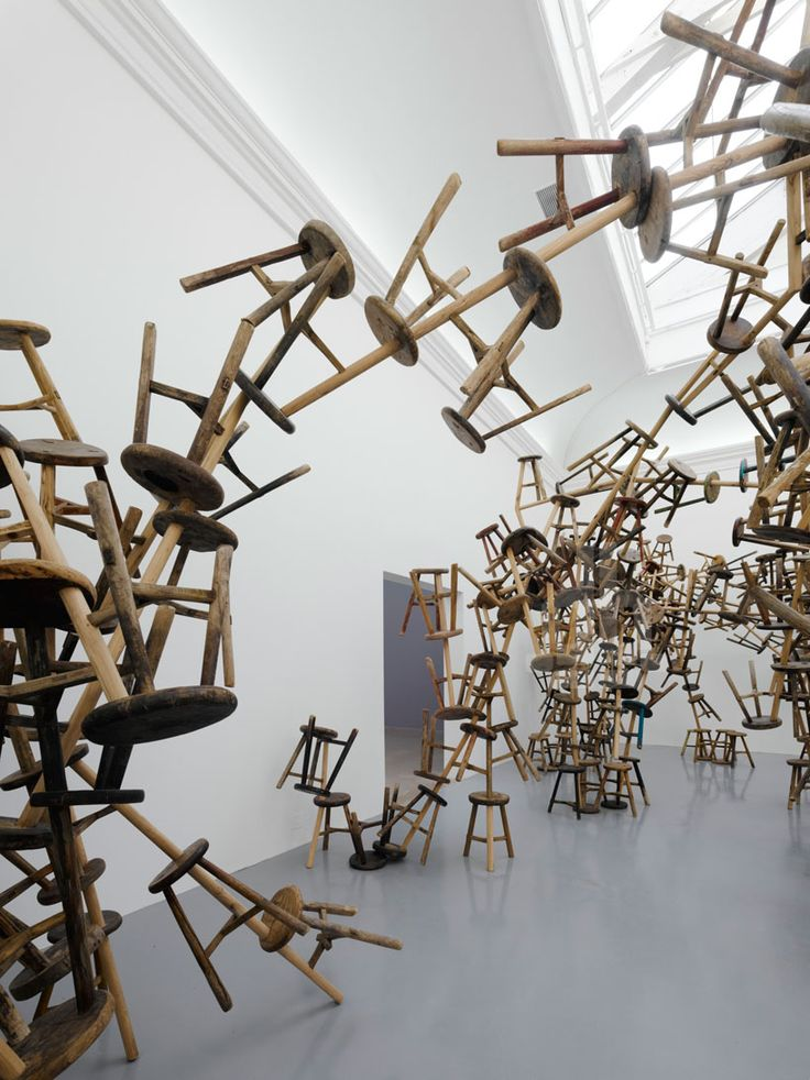 ai weiwei's 'bang installation' is an expansive rhizomatic structure composed of 886 wooden stools.