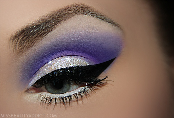 white eye shadow on lid, purple from filová shadow palette with blue, vanilla beam from makeup geek under eyebrows and blend into the blue, glitter from barry m white / lilac mix, black line elf liquid eyeliner, l'Ooreal volume million lashes, white shadow below the bottom line, white pencil to the bottom line 2in1 essence kajal pencil black and white