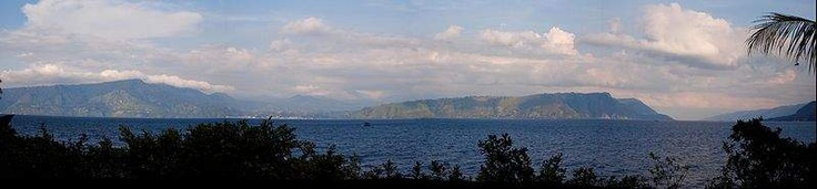 Lake Toba. Lake Toba (Indonesian: Danau Toba) is a lake and supervolcano. The lake is 100 kilometres long and 30 kilometres wide, and 505 metres (1,666 ft) at its deepest point. Located in the middle of the northern part of the Indonesian island of Sumatra.