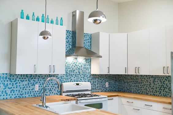Kitchen Backsplash in Aim Aqua triangular mosaic tile from MosaicTileSupplies.com