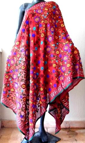 This gorgeous phulkari work georgette dupatta has been hand embroidered in a vibrant colored floral pattern, with wool thread and sequins - See more at: http://giftpiper.com/Handembroidered-Phulkari-Work-Georgette-Dupatta-Red-id-310602.html#sthash.d8xdbSsX.dpuf