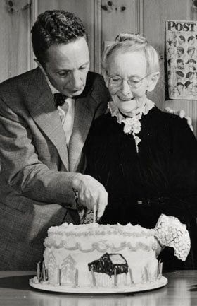 Photo of Norman Rockwell and Grandma Moses, circa 1949. Photographer Unknown. Norman Rockwell Museum Digital Collection. ©Norman Rockwell Family Agency. All rights reserved.